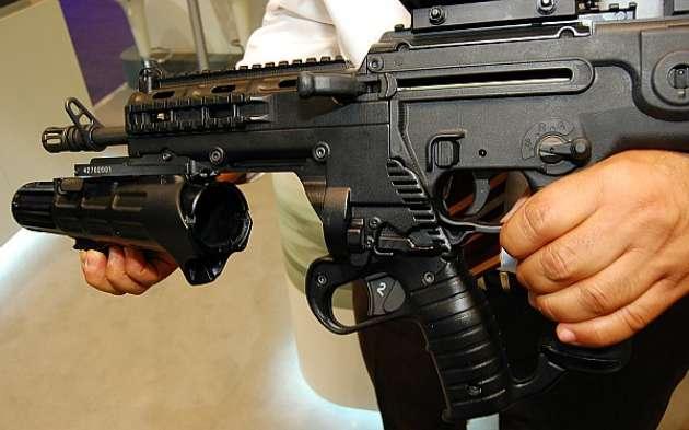 El poder de fuego del CJNG, similar al de EU ... R15 Arma